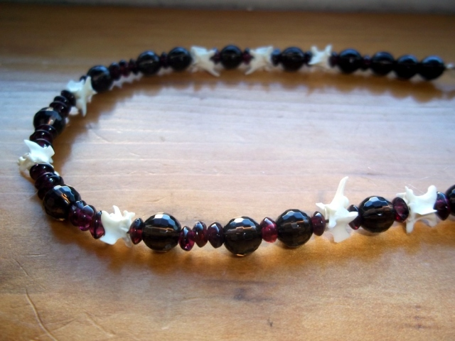 Crown with garnets, faceted smoky quartz, and rattlesnake vertebrae