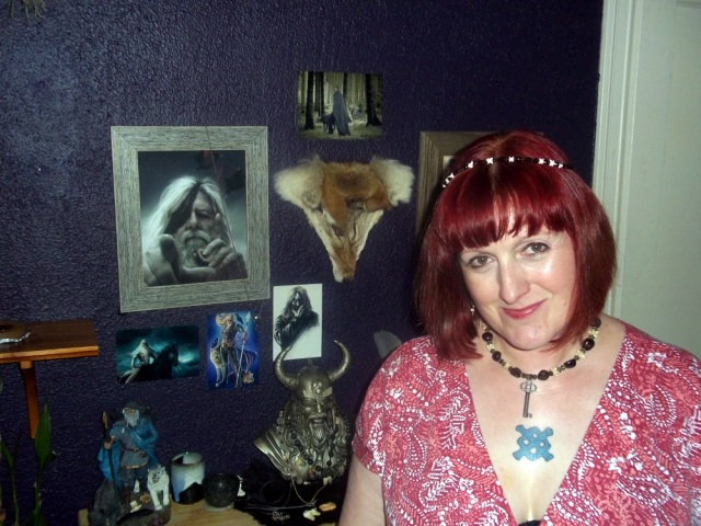 me in front my Odin shrine, prior to the ceremony; the person who took this picture was not entirely Jo