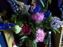 flowers for Anne: sweet-smelling lilacs and raninculus blooms, larkspur, snow balls, and broom flower (from which the Plantagenet dynasty draws its name)