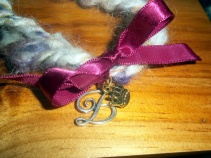 handspun cord I created as a gift for Anne, with B pendant and crown